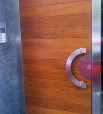 Contemporary door with horizontal panels and curved handle