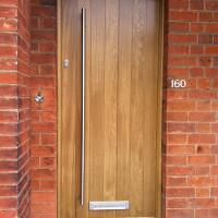 Contemporary door with vertical panels