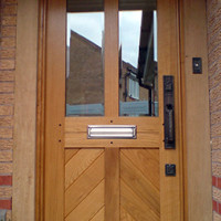 Traditional front door with four panels and chevron detailing