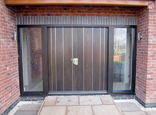 Contemporary front door with vertical panels old english for Large wooden front doors