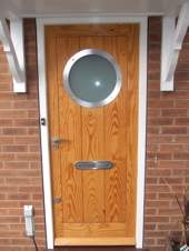 Contemporary Front Door With Porthole Window Old English