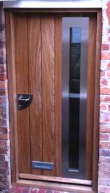 Contemporary front door with vertical panels, bespoke made to client's specifications