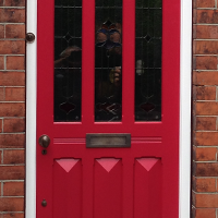 nine panel wooden front door in the edwardian style