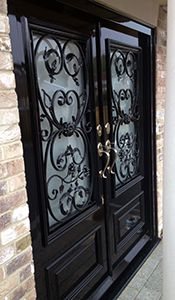 Georgian door with ornate grilles