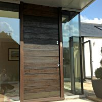 bespoke contemporary front door with horizontal boards in Ikoro