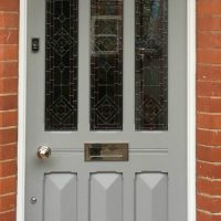 Edwardian entrance door painted in Farrow and Ball's Manor House Grey - a very modern colour