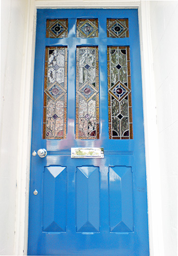 Edwardian door with nine panels of stained glass glazing
