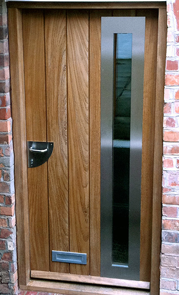 Contemporary front door with vertical boards and glazing