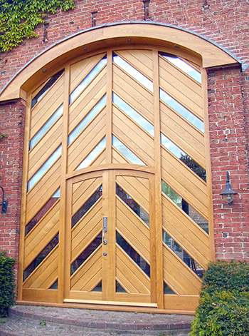 Barn door with curved hood