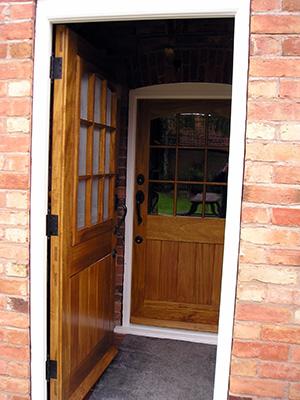 Custom glazed barn doors with casement