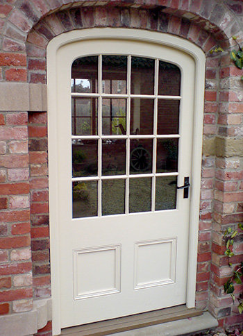 Glazed barn doors in the Georgian style with arch detailing