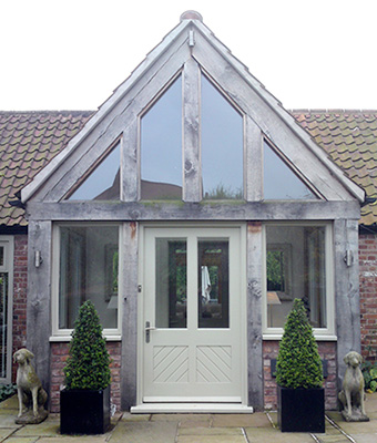 Traditional front door with chevron design and glazed panels