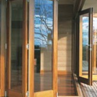Wooden bi-fold sliding patio doors