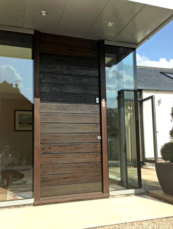 bespoke contemporary front door with horizontal boards made from Iroko timber